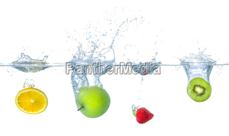 various fruits fall into the water