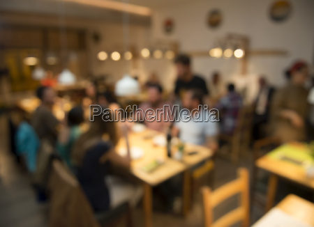 blurred image of friends at the