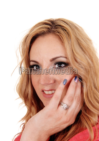 beautiful woman with finger on face