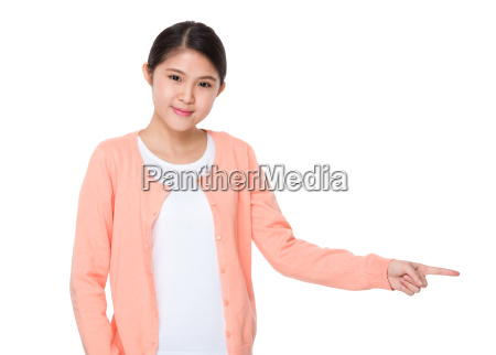 asian woman with finger point aside