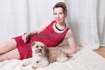 woman in red dress with dog