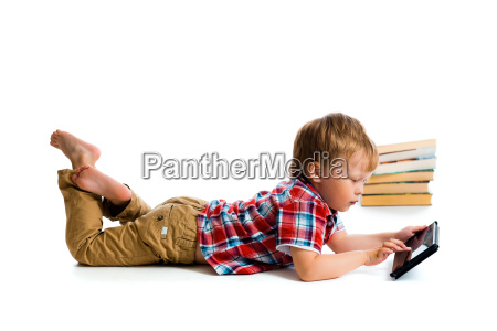 small boy with tablet computer and