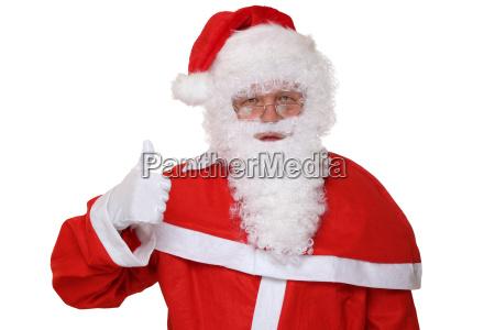santa claus shows off thumbs up