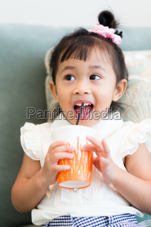excited girl drinking at home