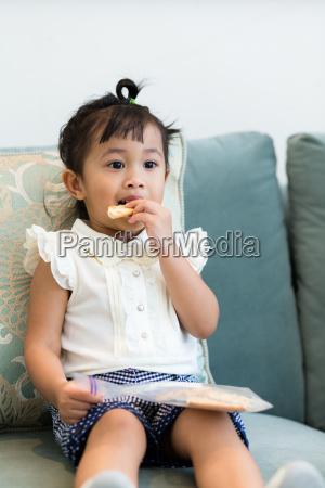 lovely girl having finger food at