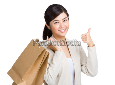 asian woman holding shopping bag and