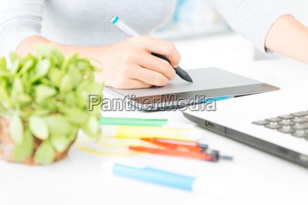 close up designer using graphic tablet