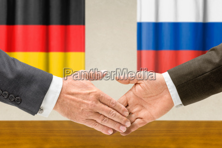 representatives of germany and russia shake