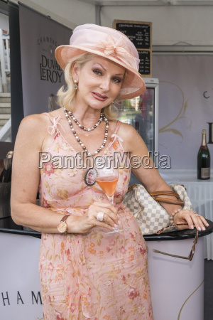 desiree nick with a champagne glass