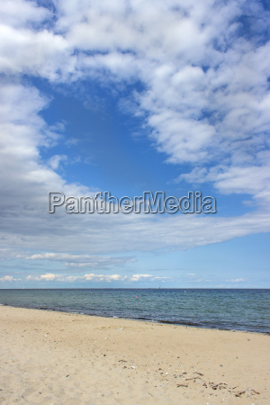 baltic sea beach with blue sky
