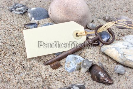 old key with pendant stones and