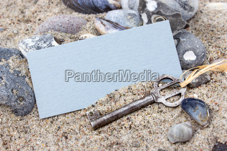 old key with card stones and