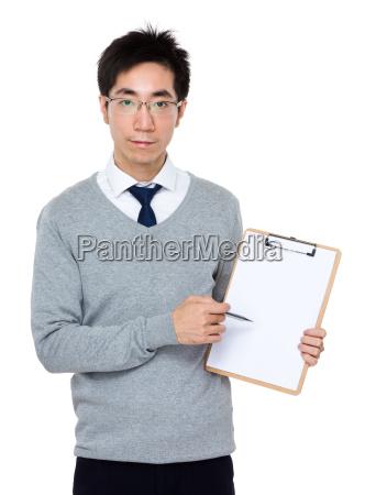 asian businessman pen point to white