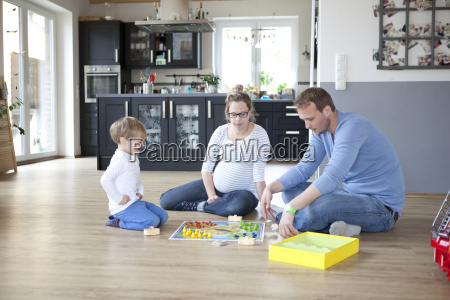 parents play with child