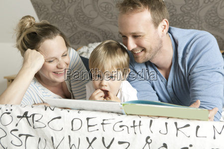 family reading childrens book