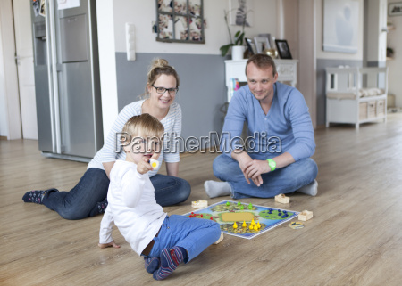 boy playing with parents