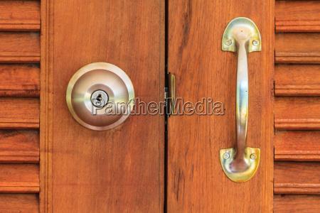 doorknob with wooden door