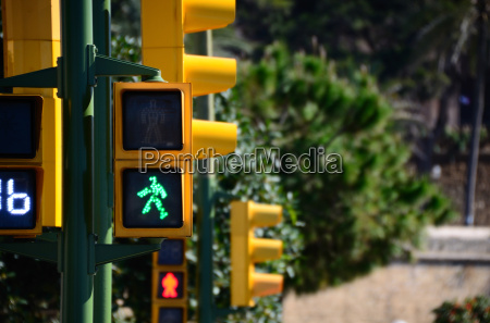 yellow traffic light with green