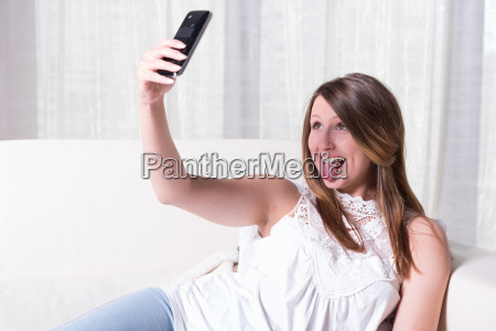 attractive young girl shooting selfie with