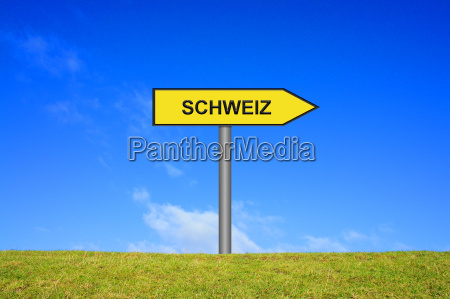 signpost shows switzerland