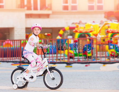 happy little girl on the bicycle