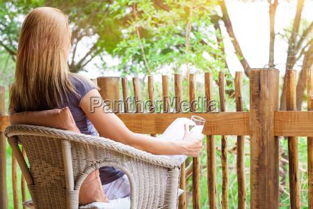 woman relaxing on terrace