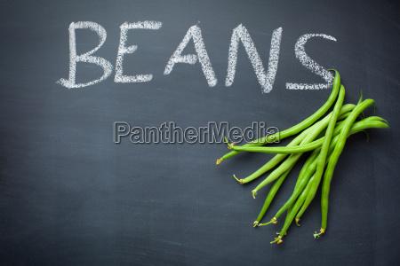 green beans on blackboard