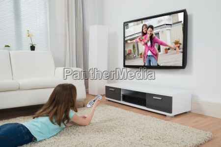 girl watching movie on television