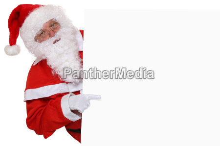 santa claus shows christmas to sign