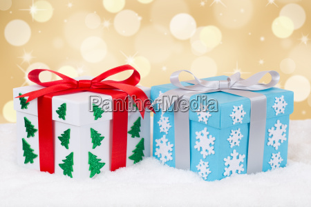 christmas gifts on christmas gold background
