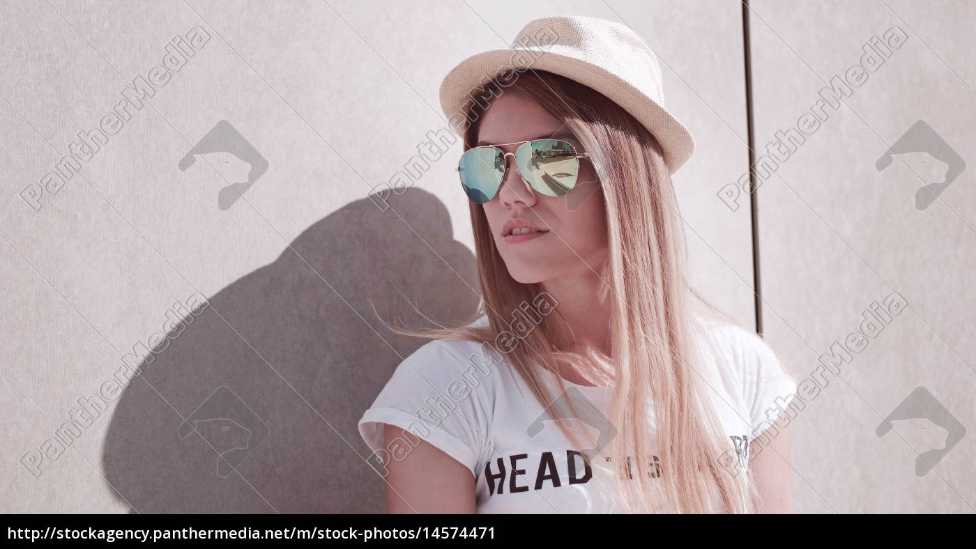Royalty Free Image 14574471 Stylish Young Woman Leaning Against The Wall