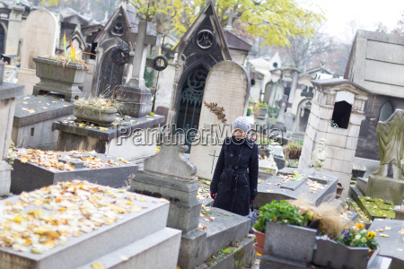 solitary woman visiting relatives grave