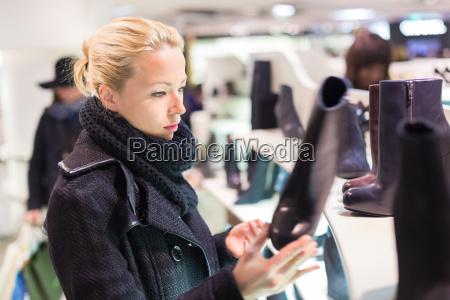 beautiful woman shopping in shoe store