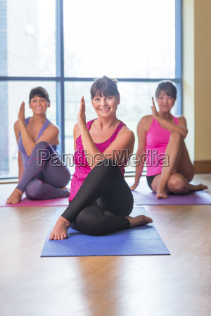 three women in a yoga pose