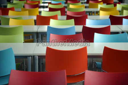 benches with colorful chairs