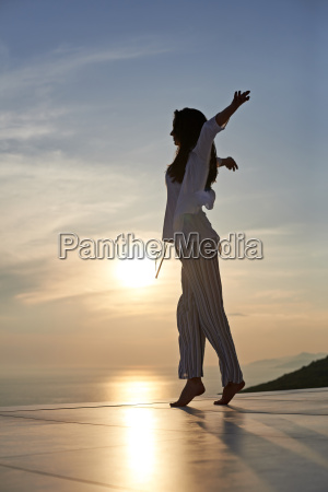 young woman enjoy sunset
