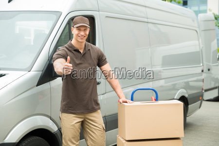 delivery man with cardboard boxes showing