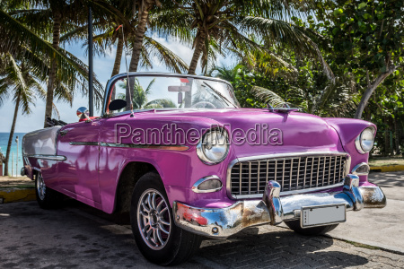 pink american convertible oldtimer parked under