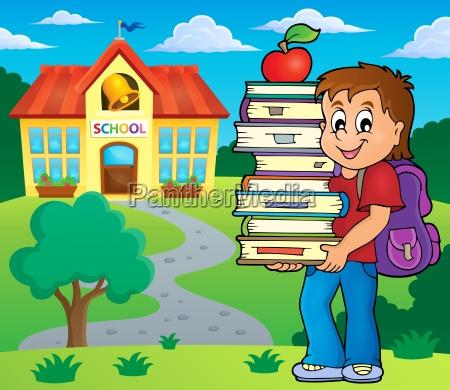 boy holding books theme image 2