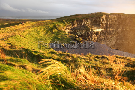 cliffs of moher at sunset in