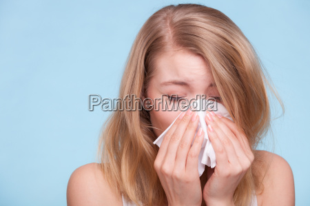 flu allergy sick girl sneezing in
