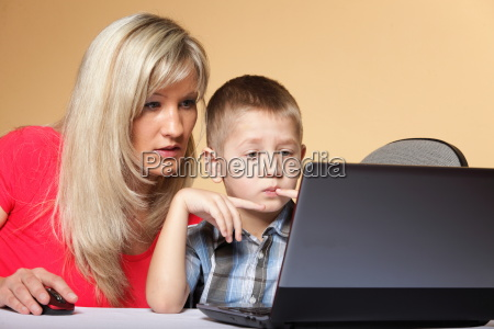 mother with son looking on the