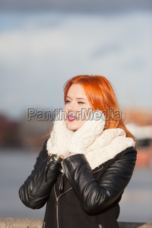 beauty red hair woman in warm