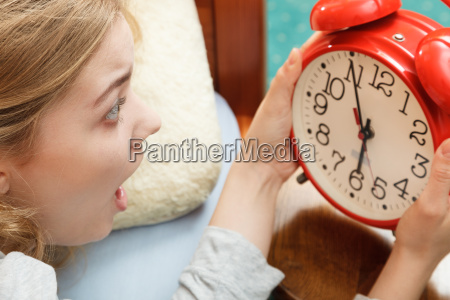 woman waking up late turning off