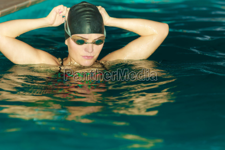 woman athlete in swimming pool water