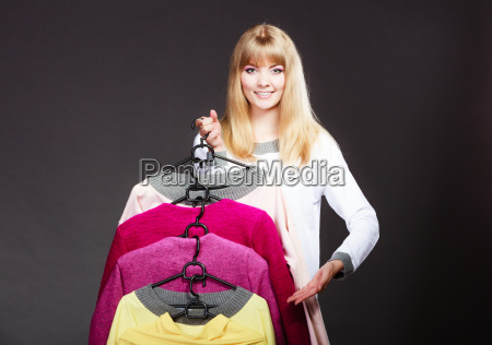 customer woman holding hangers with clothes