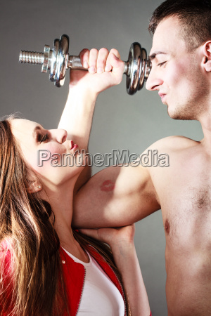 couple muscular man and girl admiring