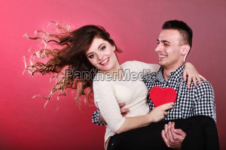 happy romantic couple with heart