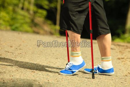 active senior legs in sneakers nordic
