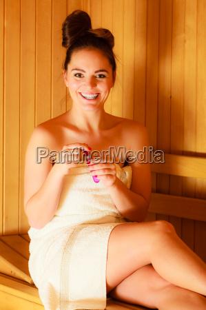 woman relaxing in a sauna room